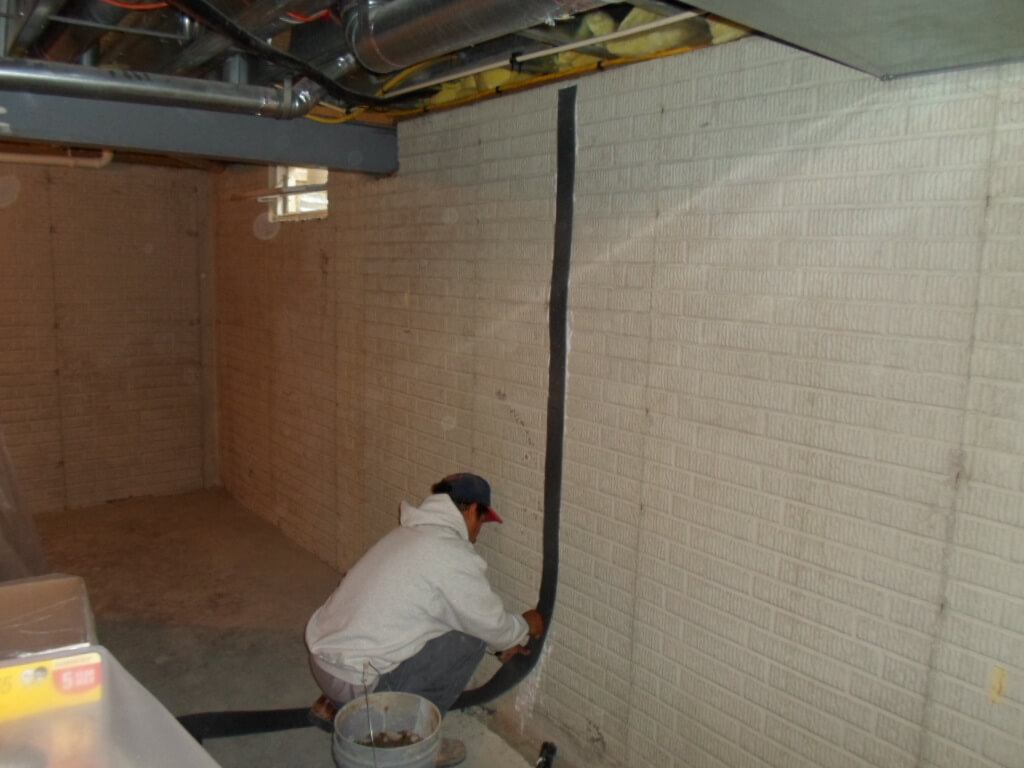 Basement Wall Crack Repair Kit Being Installed