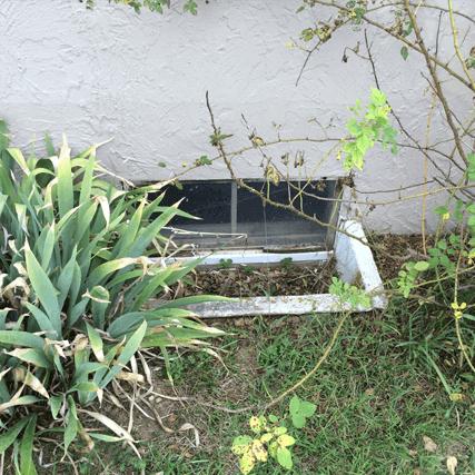 damaged window before house waterproofing